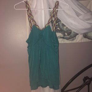 Green tank with multicolored straps